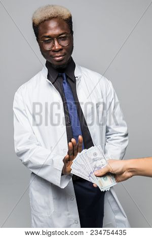 Man Giving Bribe To A Afro American Doctor Refusing The Money, Isolated On Gray Background
