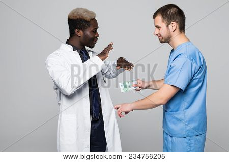 Medical Doctor Refuse Bribing Money From Surgeon Isolated On Gray Background