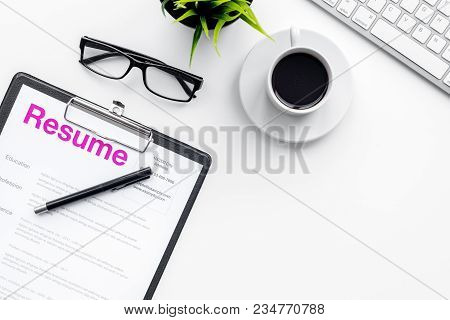 Create Resume. Resume On White Work Desk With Coffee, Glasses, Keyboard Top View.