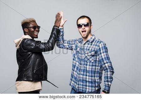 Caucasian Man And Afroamerican Man Giving High Five - Respect, Peace, Diversity Concept