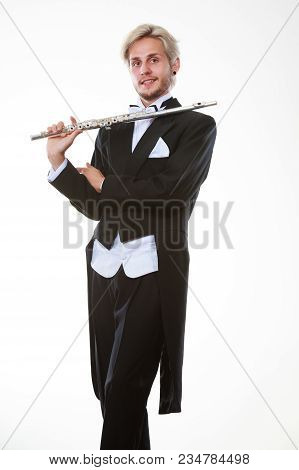 Classical Music Study Concept. Male Flutist Musician Performer Playing Flute. Young Elegant Man Wear