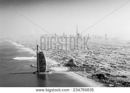 Dubai, United Arab Emirates - October 17, 2014: The Famous Burj Al Arab Hotel And Dubai Skyline Take