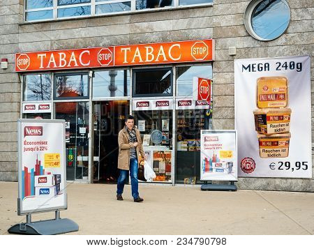 Kehl, Germany - Mar 29, 2018: Man Exit German Taback Shop Offering Cheaper Than In France Cigarettes