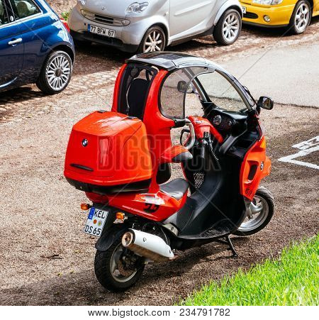 Paris, France - Circa 2018: Bmw C1 Enclosed Scooter Manufactured By Bertone For Bmw - Red On The Str