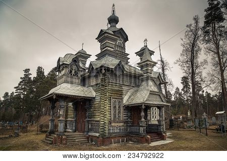St. Alexander Nevsky Orthodox Church In Daugavpils. The Church Is A One-story Wooden Log Building Th