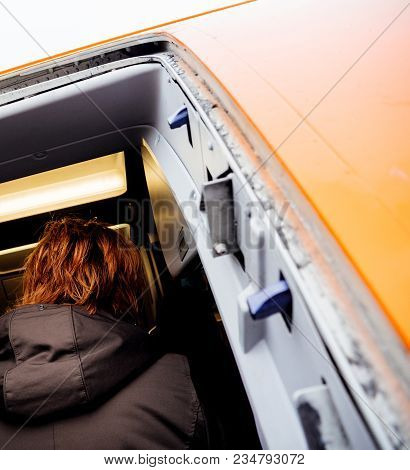 Hamburg, Germany - Mar 22, 2018: Rear View Of Passengers Entering Easyjet Airplane Early In The Morn