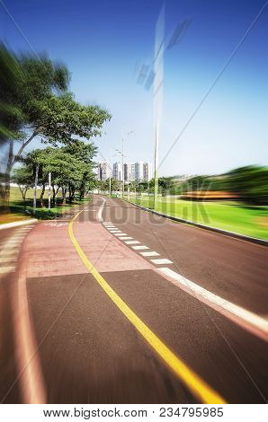 Hiking Trail And Bike Lane Surrounded By Nature On A Beautiful Day At A Park. Blurred Movement Effec
