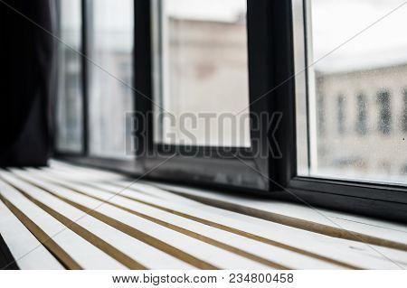 Daylight Through The Window Illuminates The Windowsill