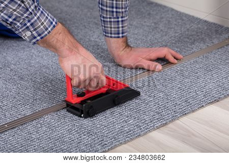 Carpet Fitter Installing Carpet With Tool