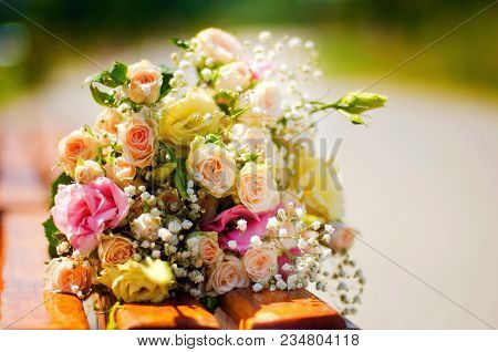 Wedding Bouquet Pink Roses And Lisianthus. Delicate Pink Gentle Roses And Little White Flowers Weddi