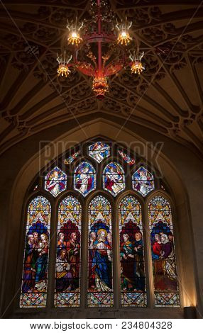 BATH, UK - JUN 11, 2013: Stained glass window of the Abbey Church of Saint Peter and Saint Paul, commonly known as Bath Abbey, an Anglican parish church and a former Benedictine monastery