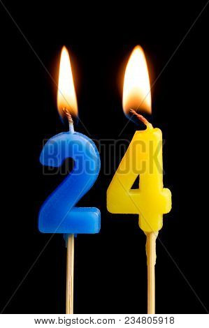 Burning Candles In The Form Of 24 Twenty Four (numbers, Dates) For Cake Isolated On Black Background