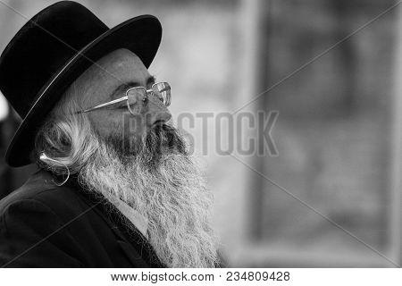 Western Wall, Jerusalem, 03.04.2015, Western Wall Jerusalem With Old Praying Men Deeply Sunken In Hi