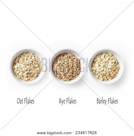 Organic Oat, Rye and Barley Flakes on White Background