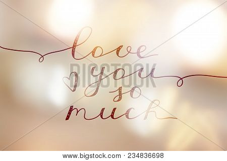 Love You So Much, Lettering On Golden Blurred Background Of Lights