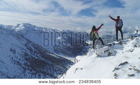 Successful People In Magnificent High Mountains ;mountaineers