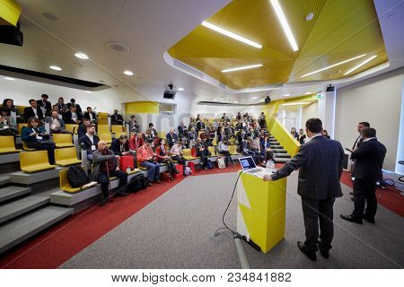 MOSCOW, RUSSIA - NOV 09, 2017: People in auditorium of Yandex company new office during conference dedicated to new application Yandex.Fuel.