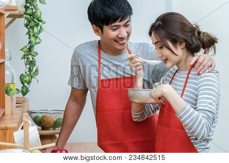 Asian Lover Or Couple Cooking And Tasting Food In The Kitchen Room At The Modern House, Couple And L