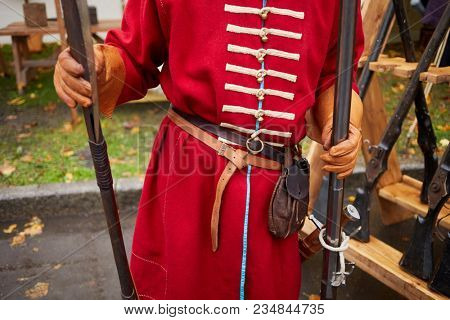 Man dressed as russian strelets (shooter) with musket and poleaxe.