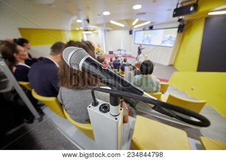 Closeup microphone in holder in auditorium.