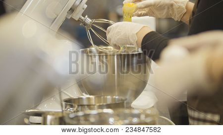 Kitchen - Beats Egg Near Electric Mixer - Cooking Cakes, Close Up