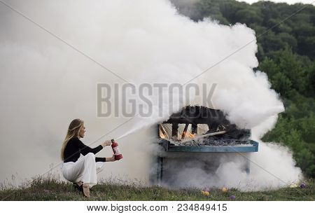 Firefighting Of Girl With Extinguisher. Firefighting With Woman Holding Fire Extinguisher Outdoor In