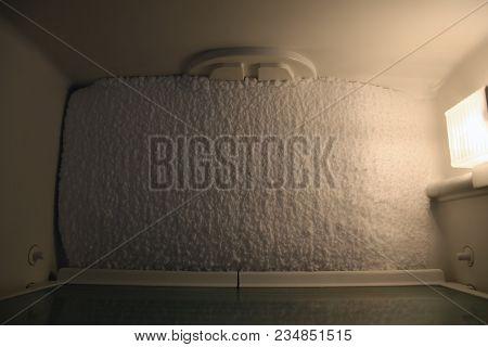Frozen Center Of The Refrigerator In The Broken Refrigerator.