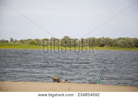 Fishing On The Lake In Windy Weather. Summer Vacation