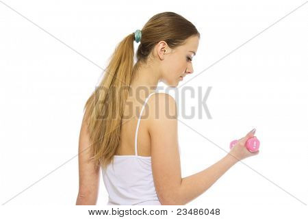 Young female doing sports isolated