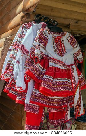 Traditional Romanian Folk Costumes For Little Girls, With Embroidery, Exposed For Sale At One Tradit