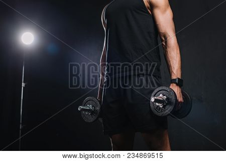 Cropped Shot Of Young African American Sportsman Holding Dumbbells On Black