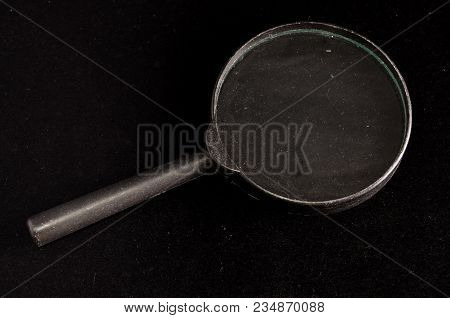 Vintage Magnify Glass Loupe On A Black Background