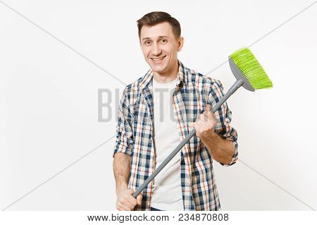 Young Smiling Happy Housekeeper Man In Checkered Shirt Holding And Sweeping With Green Broom Isolate