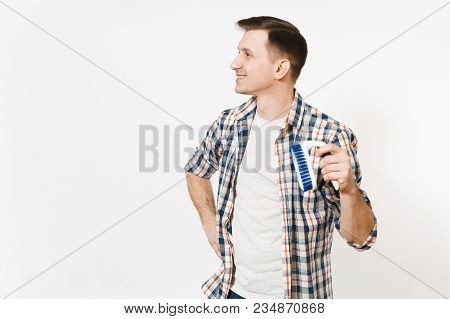 Young Smiling Housekeeper Man In Checkered Shirt Looking Aside, Holding Brush For Cleaning Isolated