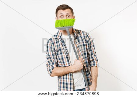 Young Smiling Housekeeper Man In Checkered Shirt Holding, Hiding And Sweeping With Green Broom Isola