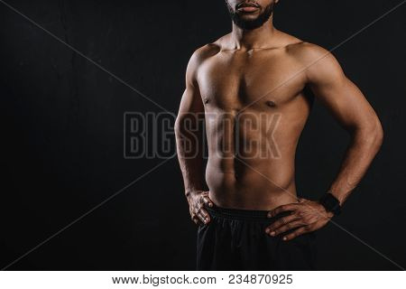 Cropped Shot Of Muscular Shirtless African American Man Standing With Hands On Waist Isolated On Bla