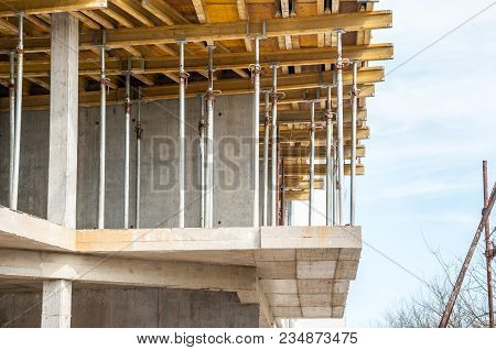 New Residential Building Construction Site With Close Up On Scaffolding And Reinforcement Timber For