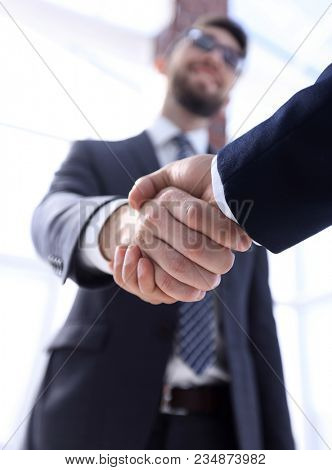 business leader shaking hands with partner.