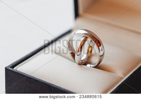 Pair Of Golden Wedding Rings In Decorative Gift Box. Beautiful Symbol Of Love And Marriage.