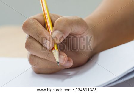 Hands With Pencil Over Application Form, Students Taking Exams, Writing Examination Room With Underg