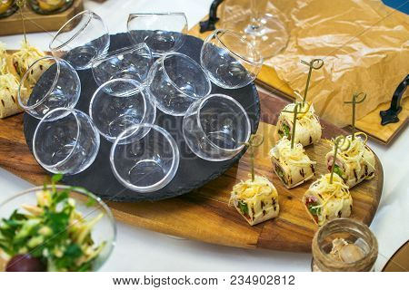 Beautiful Decorated Catering Banquet Table With Different Food Snacks And Appetizers. Canape Rolls I
