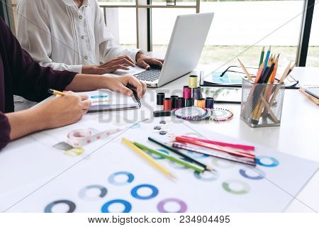 Two young dressmaker or designer colleagues working and discussing fashion project designers and drawing sketches for clothes, profession and job occupation, Fashion Designer Stylish Concept. poster