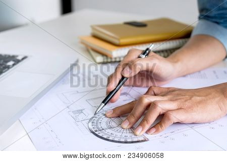 Architect Working On Blueprint, Engineer Working With Engineering Tools For Architectural Project On