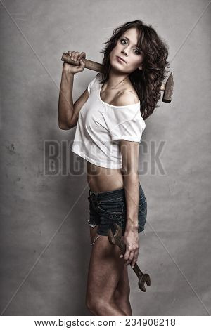 Sex Equality And Feminism. Sexy Girl Holding Hammer And Wrench Spanner Tools. Attractive Woman Worki