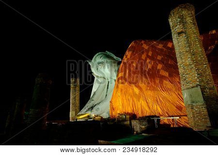 Night View Image, Reclining Old White Buddha In Wat Khunin Temple At Ang Thong Province, Thailand