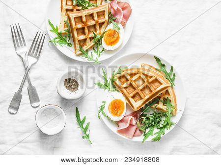 Served Breakfast With Potatoes Savory Waffles, Boiled Egg, Ham And Arugula On Light Background, Top