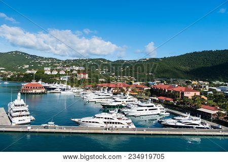 St.thomas, British Virgin Island - January 13, 2016: Yachts Moored At Sea Pier On Mountain Landscape