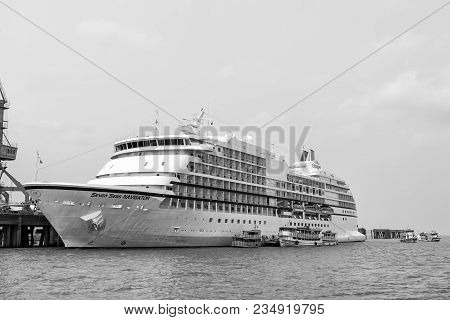 Santarem, Brazil - December 02, 2015: Seven Seas Navigator Cruise Ship Docked At Sea Harbor On Grey