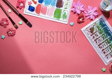 Color Gouache Jars On Pink Background. Top View, Copy Space