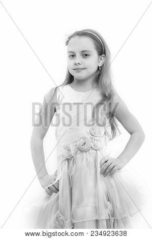 Child In Rosy Dress Pose Isolated On White. Fashion, Look, Beauty And Style. Girl With Flower Access